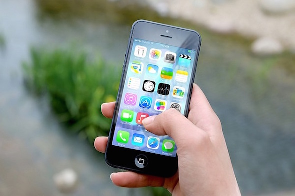 Apple iPhone 5 held in a hand
